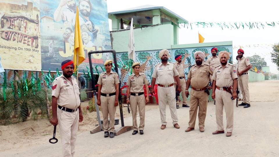 Punjab police personnel standing guard at the gate of Salabatpura based Punjab headquarters of Dera Sacha Sauda in Bathinda on Thursday.