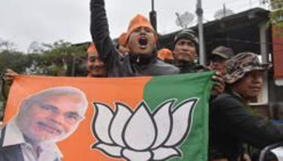 BJP supporters celebrate assembly elections results in Imphal, Manipur, where the BJP weaned away six MLAs from the ruling Congress ahead of polls.