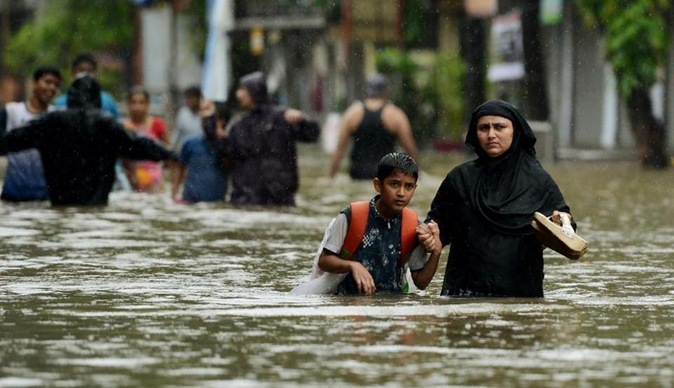 Dozens of flights and local train services were cancelled as rains lashed the coastal city of nearly 20 million people.