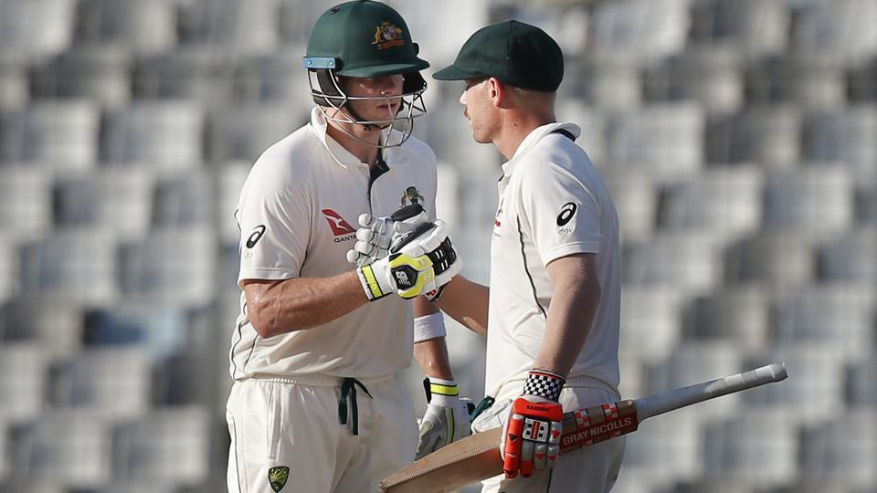 Australian cricket team captain Steve Smith, left, congratulates his teammate David Warner for scoring a gutsy fifty during the third day of the first Test against Bangladesh in Dhaka on Tuesday. Get full cricket score of Bangladesh vs Australia 1st Test here