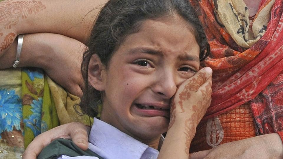 Abdul Rashid's daughter Zohra cries during the wreath-laying ceremony at the police headquarters in Srinagar.
