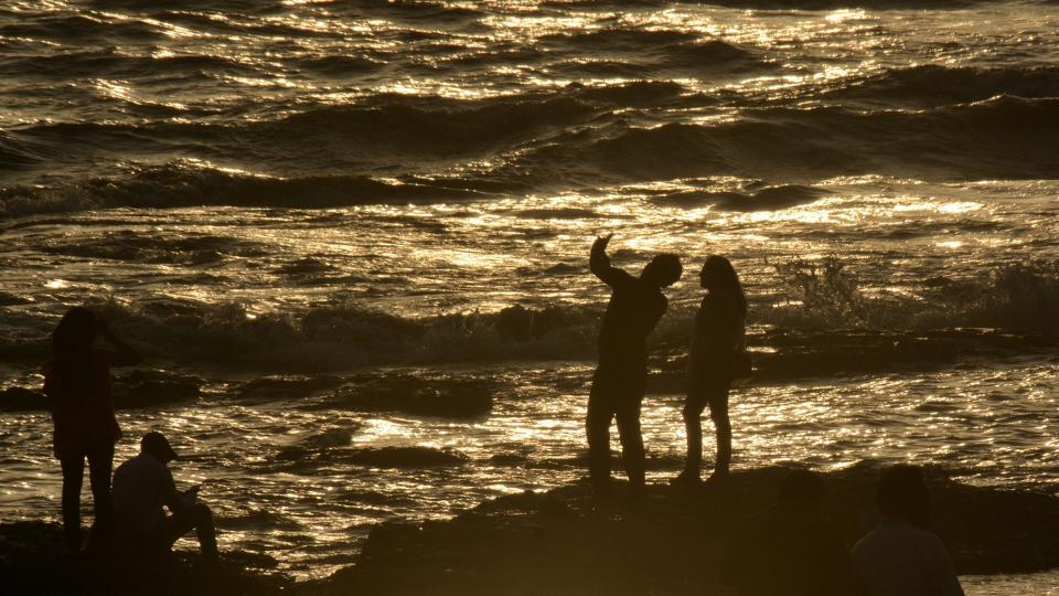 People take selfie along the shore in Mumbai. Selfies in treacherous settings have been linked to several deaths in India since the last year.