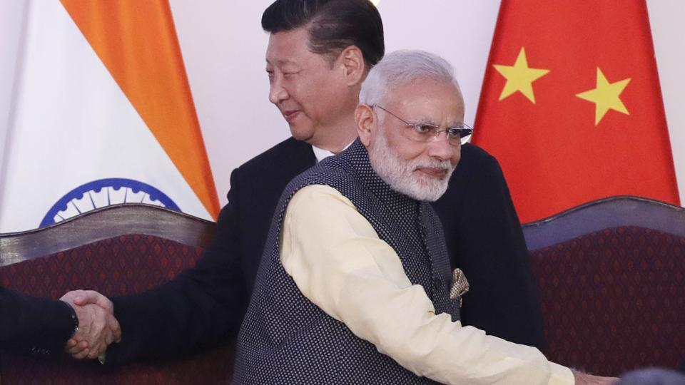 File photo of Prime Minister Narendra Modi with Chinese President Xi Jinping at the BRICS summit in Goa in October last year.