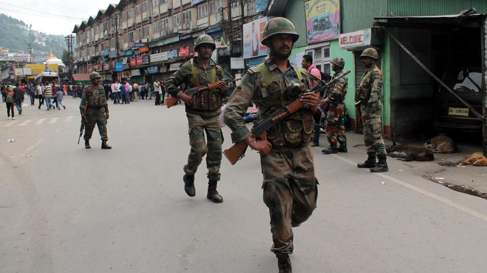 File picture of army personnel patrolling the streets of Darjeeling. The dominant question in the hills now is when will the indefinite shutdown end.