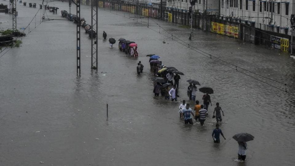 Heavy rains continue to lash Mumbai leading to waist deep water logging in several areas of city, slowing down traffic movement and delaying flights and the suburban railway system leaving thousands stranded. On Tuesday, the Santacruz weather station, representative of the suburbs and rest of Mumbai, recorded 331.4 mm rain, categorised as 'extremely heavy'. 15 deaths have been reported as of Wednesday in Maharashtra. (Kunal Patil/ HT Photo)