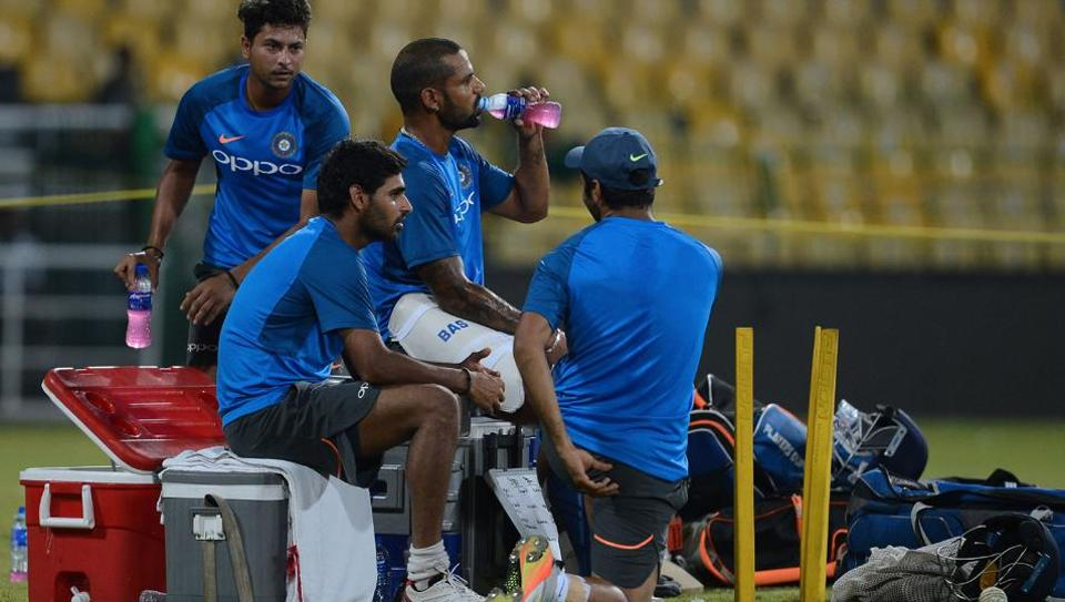 The likes of Dhawan, Bhuvneshwar Kumar take a break from their intense practice session.  (AFP)
