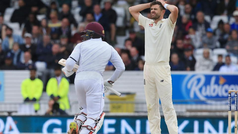 England's James Anderson (R) reacts as West Indies' Shai Hope completes a run on the fifth and final day of the second Test match at Headingley cricket ground in Leeds on August 29, 2017.