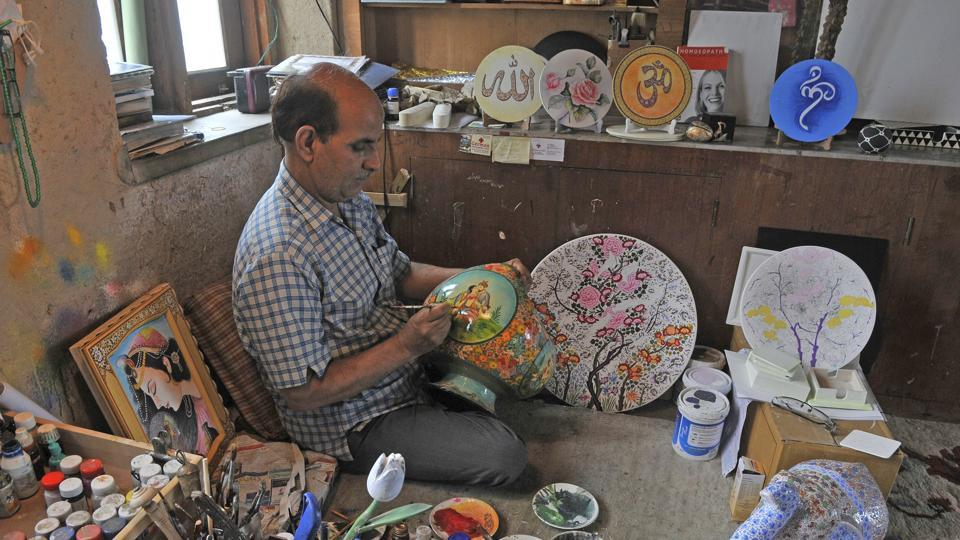 The products reflect a subtle grammar of motif and style. The traditional 'hazara' or 'thousand flowers' and 'gulandergul' or 'flower within flower' are among the popular design motifs of papier mache products. Border patterns such as 'gondur' and 'tyond' are generally geometric abstracts. There are few other popular patters as well of the Persian rose, the chinar leaf, the almond and cherry blossom and the iris among others. (Waseem Andrabi / HT Photo)