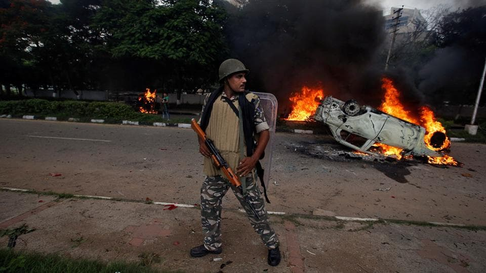 A member of the security forces reacts during violence in Panchkula on August 25.