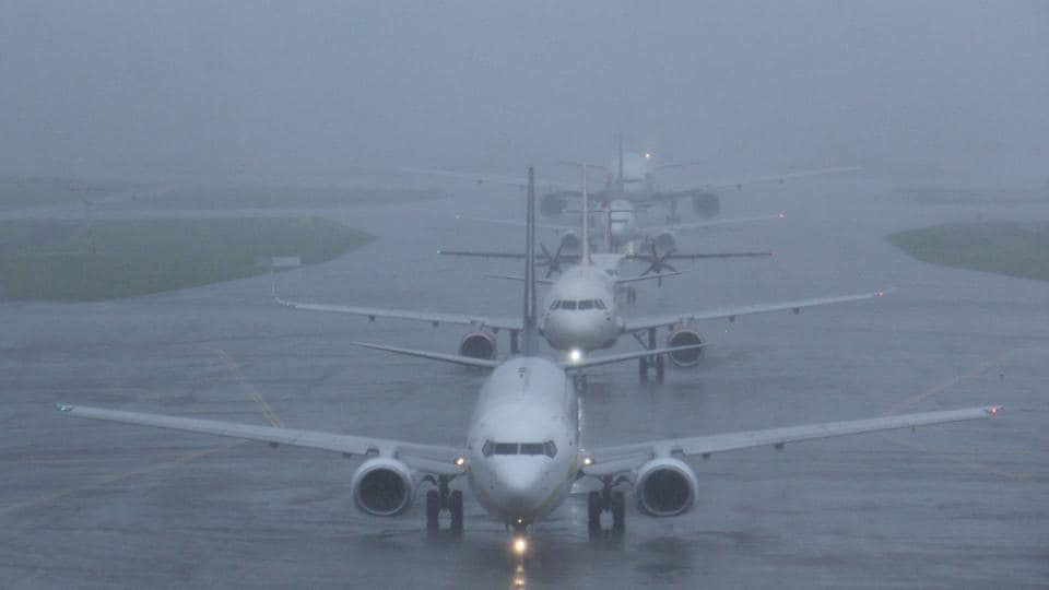 Flights were lined up to take off despite heavy rains in Mumbai yesterday. As of Wednesday flight services are slowly resuming as airport staff arrive. Helicopter operations have resumed at Juhu aerodrome. Navi Mumbai Municipal Transport is running 55 extra buses to ferry people from satellite towns while traffic remains slow. (Pramod Thakur / HT PHOTO)