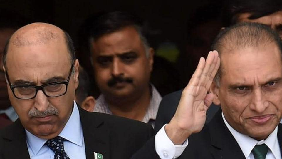 File photo of Pakistan's former foreign secretary Aizaz Ahmad Chaudhry(right) waving as he walks with Pakistan's former envoy to India, Abdul Basit, after he arrived at Indira Gandhi International Airport in New Delhi on April 26, 2016.