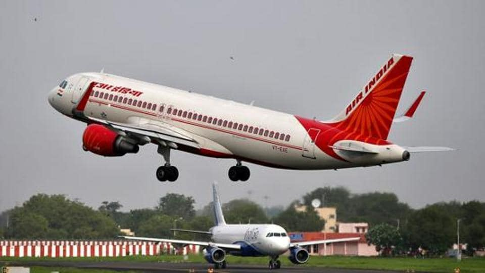 An Air India aircraft takes off as an IndiGo Airlines aircraft waits for clearance at the Sardar Vallabhbhai Patel International Airport in Ahmedabad on July 7.