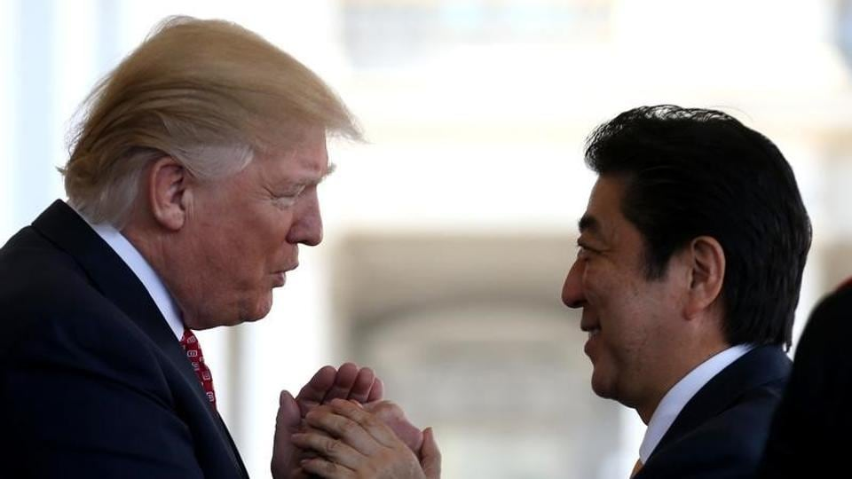 Japanese Prime Minister Shinzo Abe (R) is greeted by US President Donald Trump at the White House in Washington, in February.