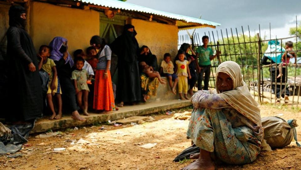 New Rohingya refugees sit near the Kutupalang makeshift refugee camp, in Cox's Bazar, Bangladesh, August 29, 2017.