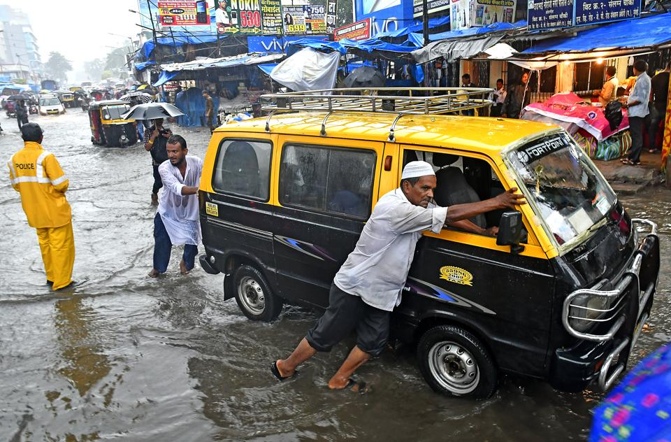 Flooded roads at Andheri, Mumbai,  August 29. Twelve years later, the downpour was only a third of that in 2005, but the impact was nearly as bad.