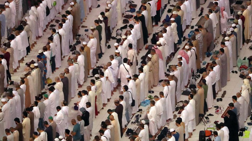 Muslim pilgrims pray at the Grand Mosque in the holy Saudi city of Mecca, on August 29, 2017, on the eve of the start of the annual Hajj pilgrimage.