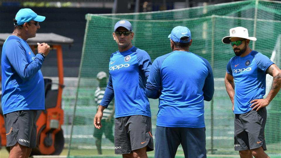 Skipper Virat Kohli and Mahendra Singh Dhoni with head coach Ravi Shastri and bowling coach Bharat Arun during a practice session in Colombo ahead of the 4th ODI against Sri Lanka.