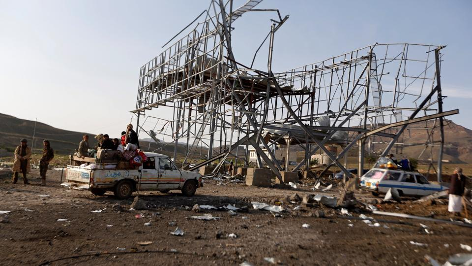 Vehicles carrying travellers pass by a checkpoint of the armed Houthi movement after it was hit by a Saudi-led air strike near Sanaa, Yemen August 30, 2017.