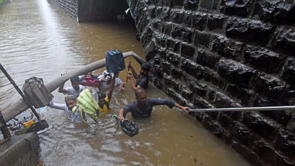 Four persons were washed away in separate incidents in Mumbai since Tuesday, said PTI quoting police. The incidents were reported from Dahisar, Kandivli, Malad and Dadar. Another man died after falling into an open manhole on Dadar's Matkar road, ANI reported. (Pratik Chorge / HT Photo)