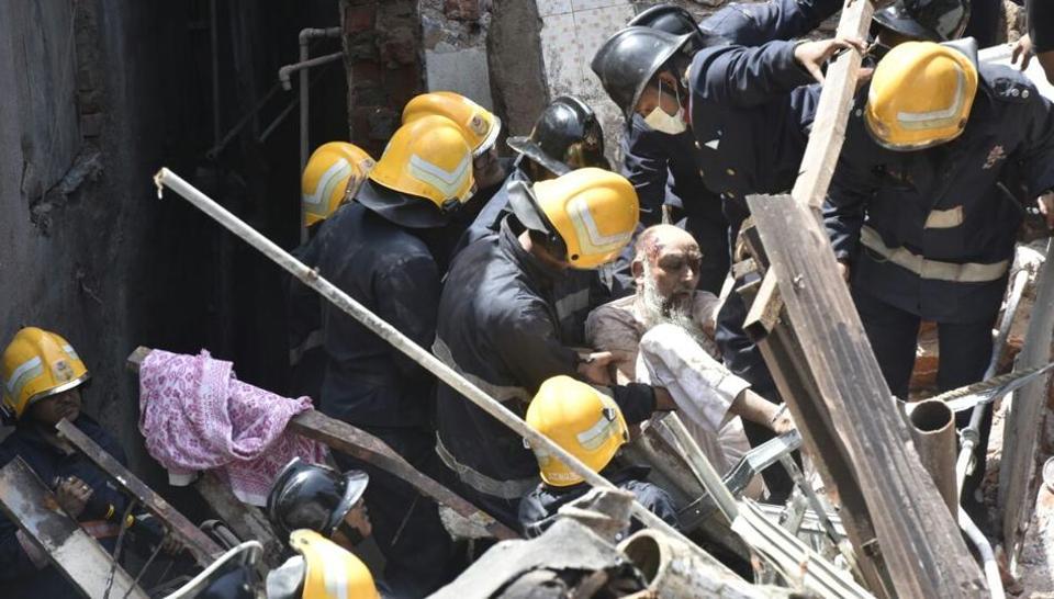 A man being rescued at Bhindi Bazar.