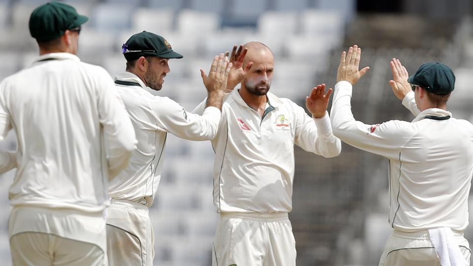 Australia's Nathan Lyon, second right, celebrates with teammates during the first Test against Bangladesh.