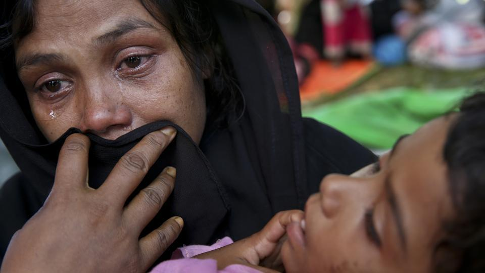 A Rohingya woman breaks down after being stopped by Bangladeshi border guards at a makeshift shelter at Ghumdhum, Bangladesh. The United Nations while condemning the militant attacks has pressured Myanmar to protect civilian lives without discrimination and appealed to Bangladesh to admit those fleeing the military counteroffensive. (Mushfiqul Alam / AP)