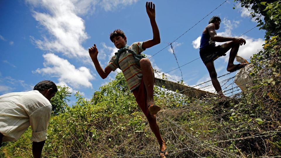 A Rohingya boy jumps over the border fence to enter inside Bangladesh border in Cox's Bazar,Bangladesh.More than 18,500 Rohingya Muslims, many sick and some with bullet wounds have fled the worst violence to grip northwest Myanmar in at least five years with thousands more stuck at the Bangladesh border or scrambling to reach it since clashes between Rohingya insurgents and government forces erupted last week.  (Mohammad Ponir Hossain / REUTERS)