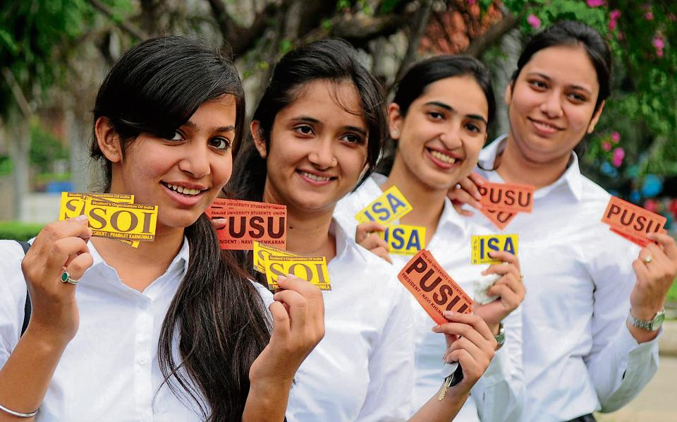 Girls showing stickers of various in Panjab University in Chandigarh on Thursday.