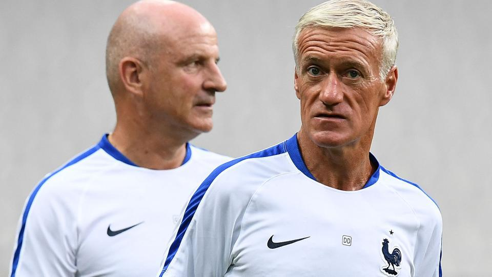 France's head coach Didier Deschamps (R) and assistant supervises a training session at the Stade de France stadium.