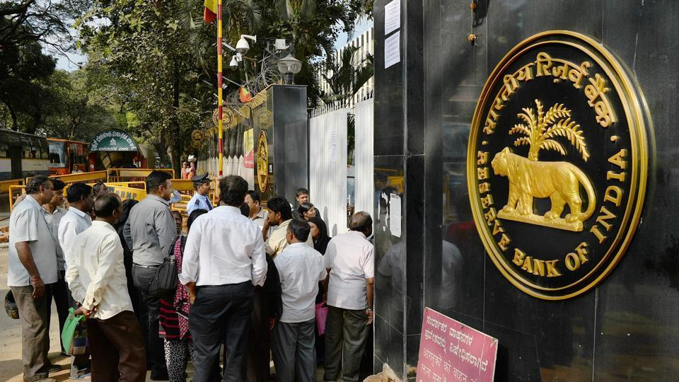 People waiting to exchange demonetised currency make enquiries at the closed gates of Reserve Bank of India in Bangalore on January 2.
