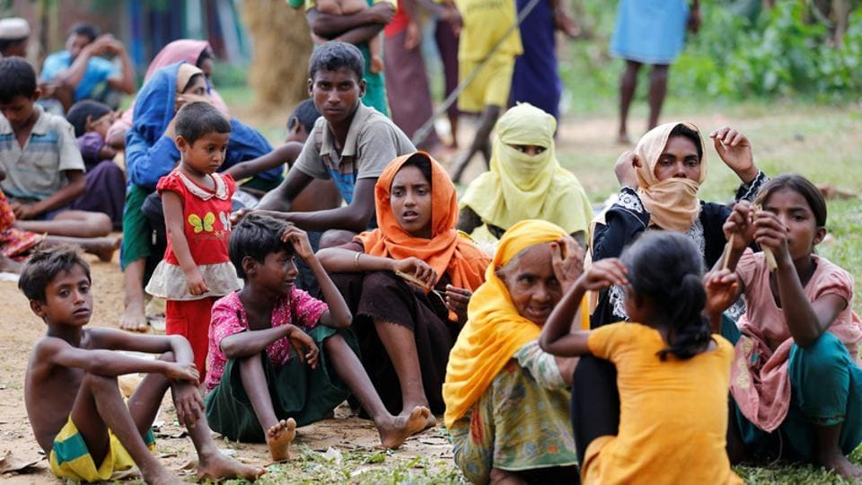 New Rohingya refugees wait to enter the Kutupalang makeshift refugee camp, in Cox's Bazar, Bangladesh.