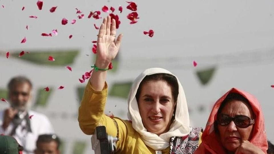 Pakistan's former prime minister Benazir Bhutto waves to supporters on her way to Shahdad Kot, where she was going to submit her nomination papers for national assembly to the district session court judge, some 515 km (320 miles) north of Karachi November 26, 2007.
