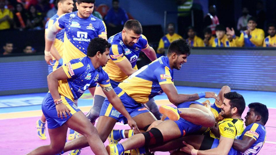 Telugu Titans (orange) and Tamil Thalaivas (Blue) players in action during their Pro Kabaddi League match in Mumbai on Thursday.