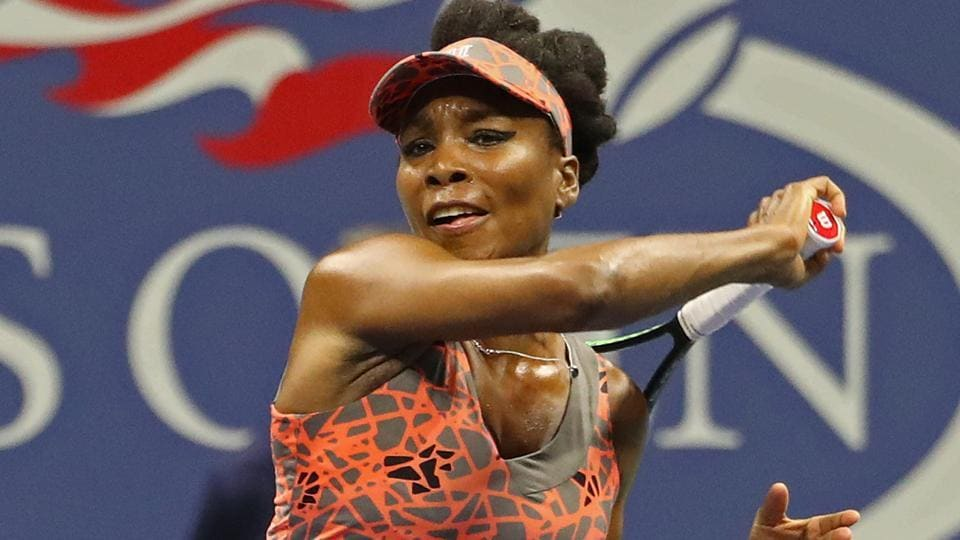 Venus Williams hits a forehand against Oceane Dodin at the USOpen.