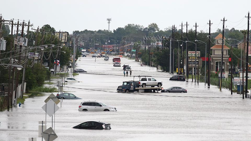 A flooded street in Houston , Texas. Monster storm Harvey made landfall again Wednesday in Louisiana, evoking painful memories of Hurricane Katrina's deadly strike 12 years ago, as time was running out in Texas to find survivors in the raging floodwaters.