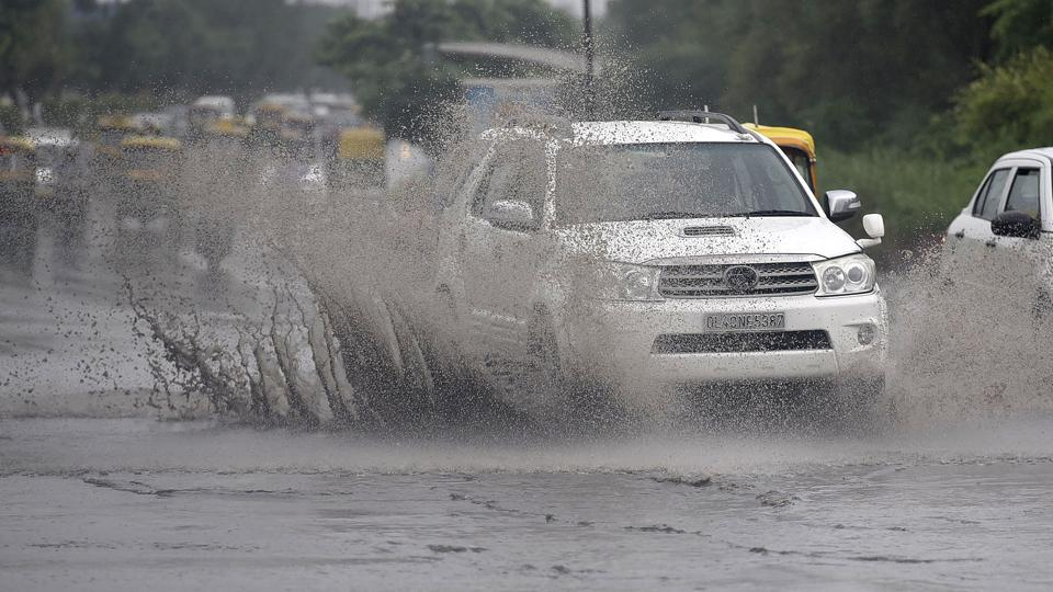 Vehicles wade through waterlogged roads in New Delhi on  Thursday.