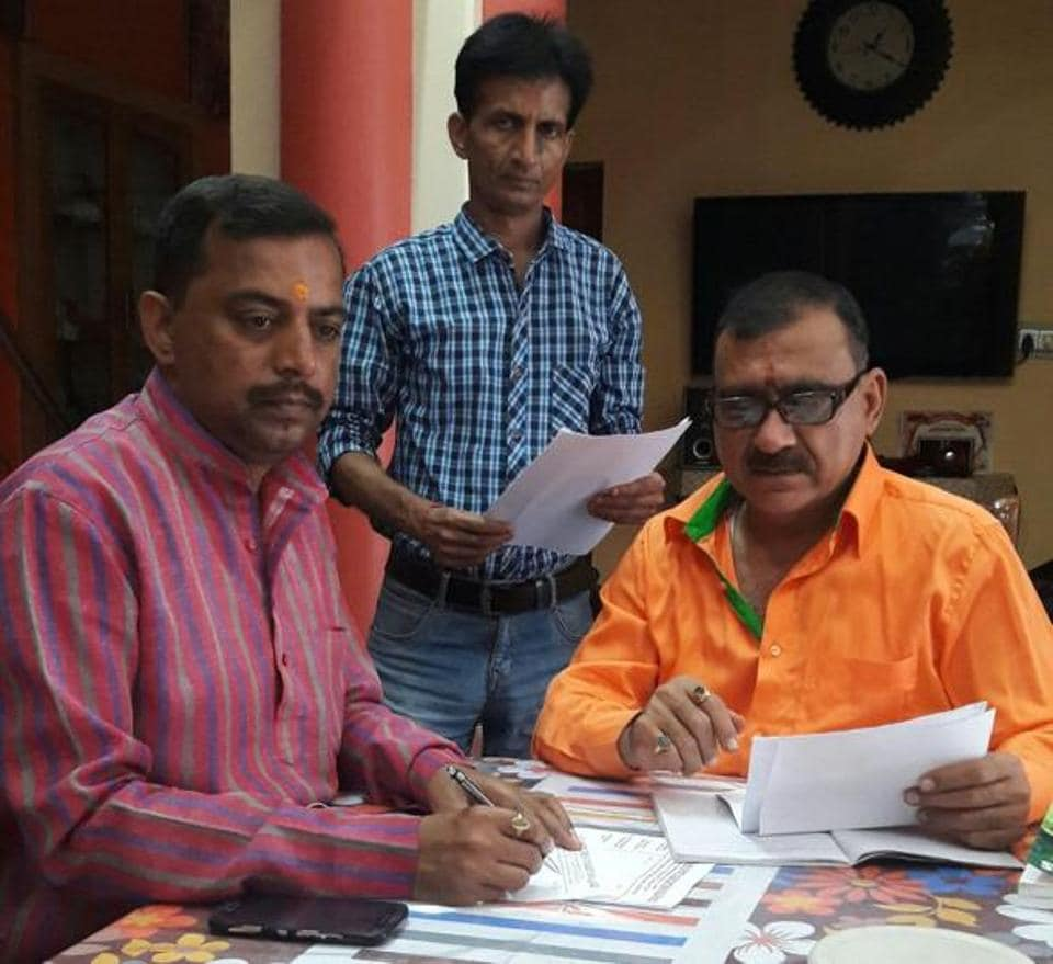 Pandit Shyamji Pathak, ND Singh and Anandji (pappanji) Tandon preparing for the chess championship.