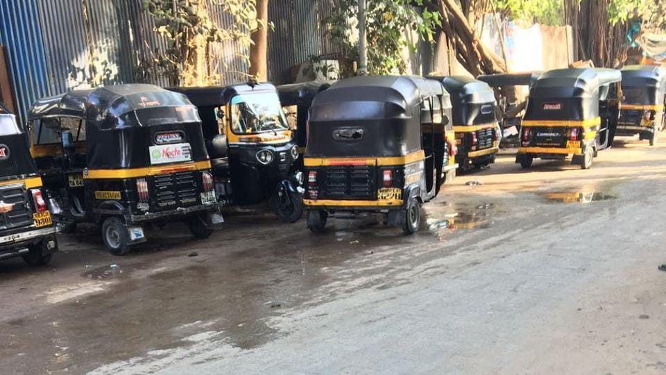 Auto illegally parked on the road leading to Versova beach.