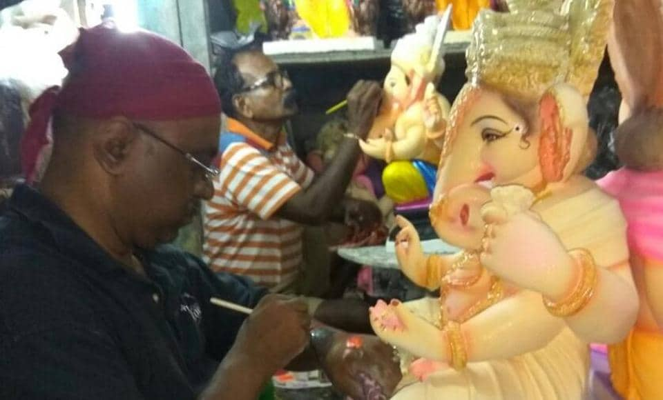 Constable Vinod Vichare works on an idol.