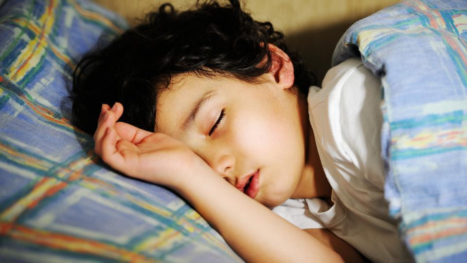 Children may learn sleep habits from their parents.
