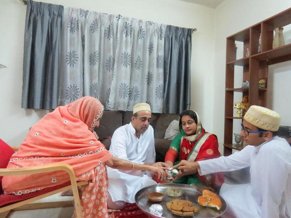 Sakina, Aliasgar, Farzana and Mohammed Mukthiar start their meal with a pinch of salt on the occasion of Bakri Eid.