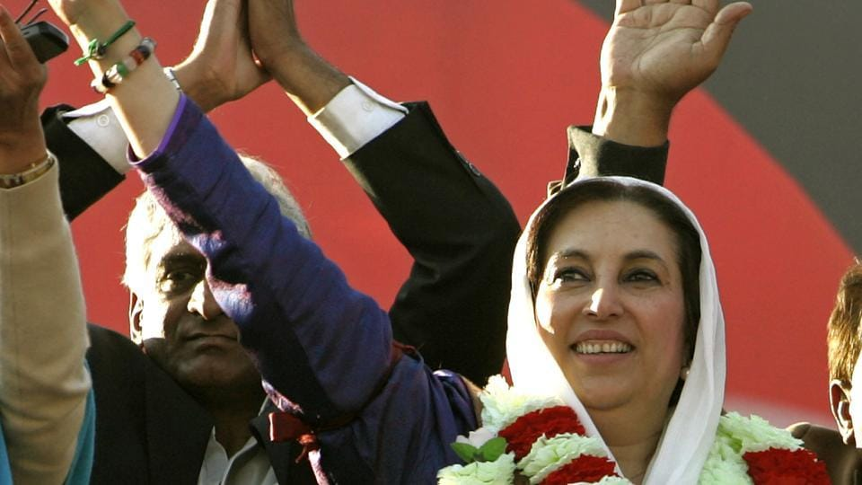 File photo from December 27, 2007 shows former Pakistani prime minister Benazir Bhutto waving to supporters during her last public rally in Rawalpindi shortly before she was assassinated.