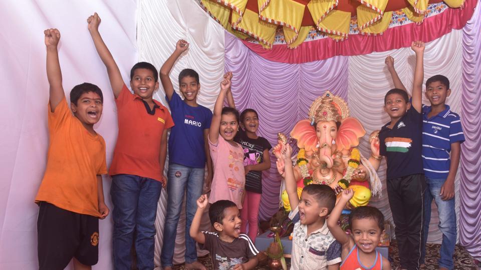 Children of Shree Ganesh Mitra mandal, Sutarwada shout Ganpati Bappa Morya near their Ganesh idol in Pune on Friday.