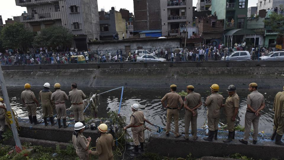 Two people died in East Delhi after a part of the Ghazipur garbage landfill collapsed on Friday afternoon, sweeping several people on a road nearby into a canal.
