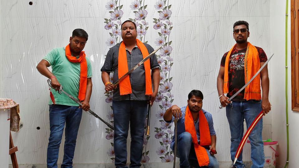 Hindu Yuva Vahini members pose inside the vigilante group's office in the city of Unnao, India, April 5, 2017.