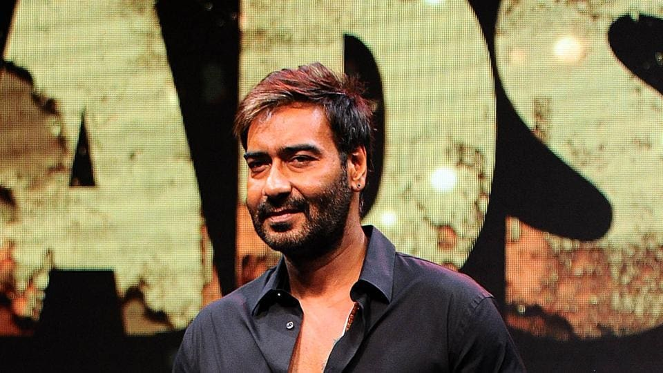 Ajay Devgn poses for pictures during the trailer launch of Baadshaho directed by Milan Luthria in Mumbai.