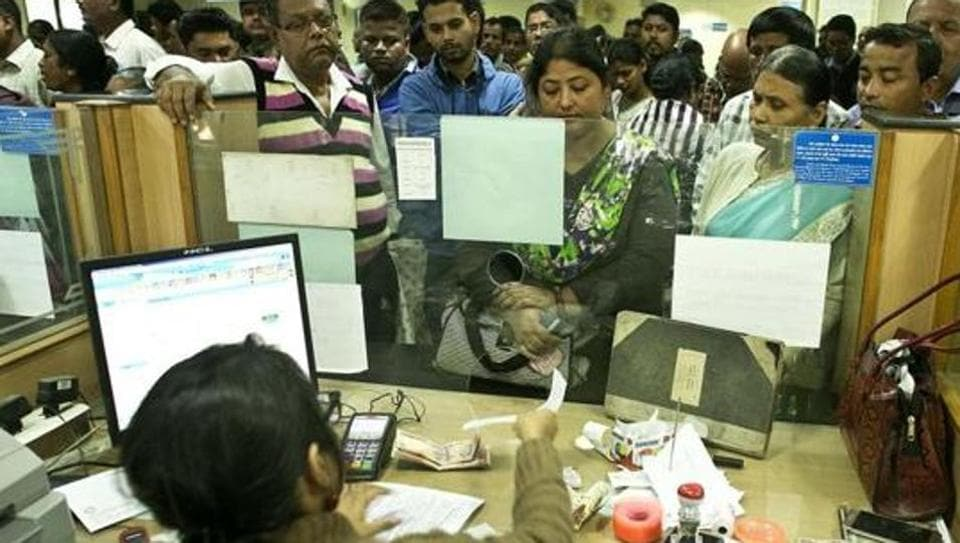 People deposit discontinued notes in a bank on the last day for depositing Rs 500 and Rs 1,000 notes  in Guwahati,  Dec. 30, 2016.