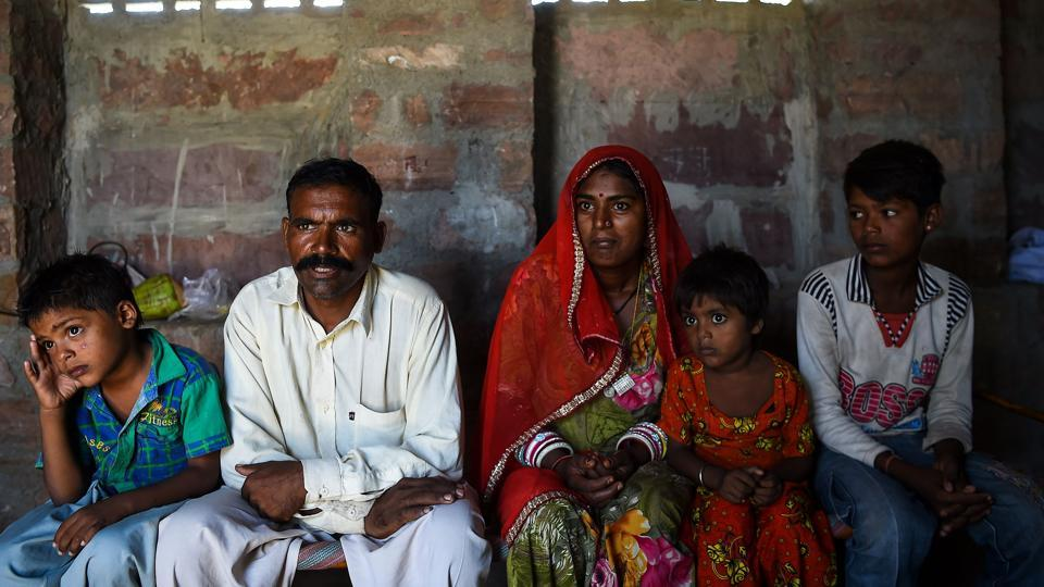 This photo taken on June 16, 2017 shows a family of Pakistani Hindus living in an unauthorised settlement in Jodhpur in India's western state of Rajasthan.