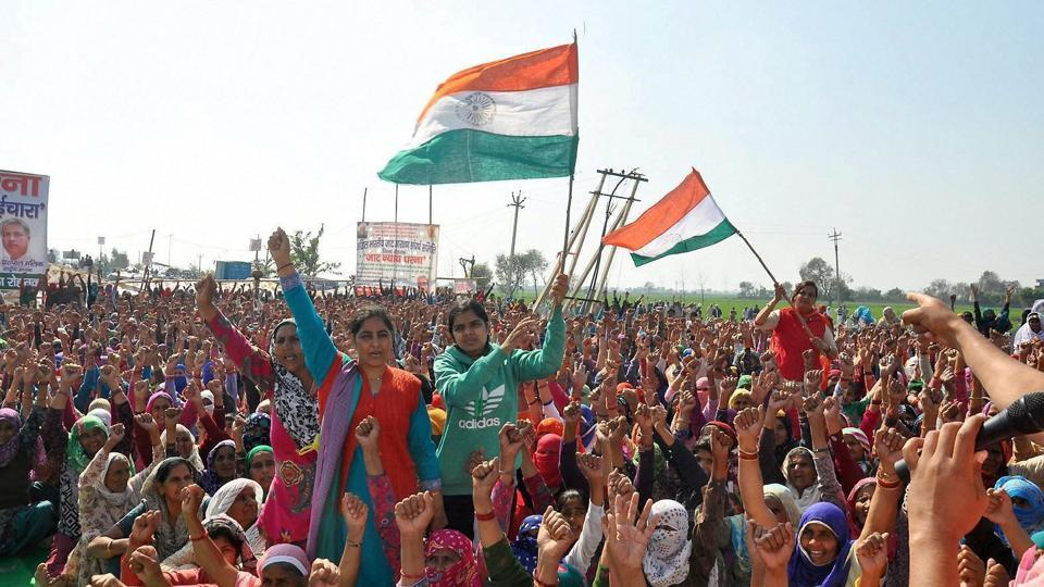 Protesters wave the Tricolour during an agitation for reservation in Rohtak. The Punjab and Haryana high court is likely to deliver its verdict on petitions challenging 10% reservation to Jats and five other communities.