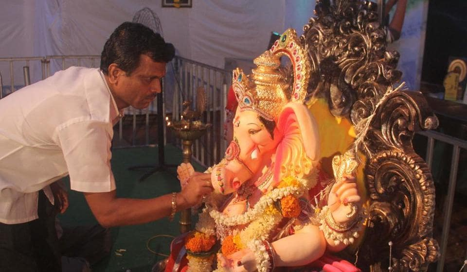 Our idol is cleaned about ten times a day because people are constantly showering it with rice and flowers, says Nitin Hanjankar, idol caretaker at the Paralcha Raja pandal.